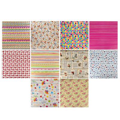 207-009 Бумага упаковочная, 70х100 см, мелованная, 65-70 г, 16 дизайнов
