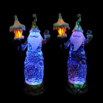 N01-005 СНОУ БУМ Светильник LED Дед Мороз с фонарем, с водой и блестками, пластик, 30,5х9,3 см,3хААА,2 цвета