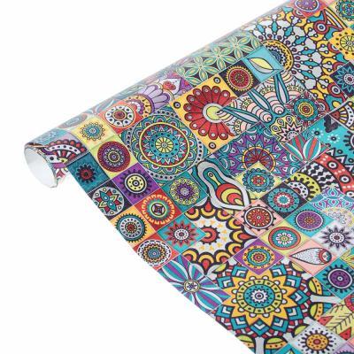 207-028 Бумага упаковочная мелованная с блестящим слоем, 67,2 см х 99 см, 10 дизайнов